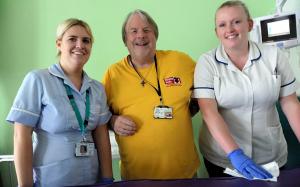 Volunteer with Hospital Staff